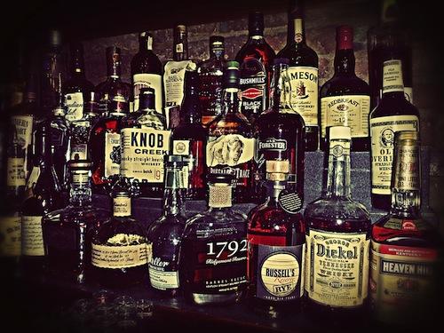 11 whiskey bottles